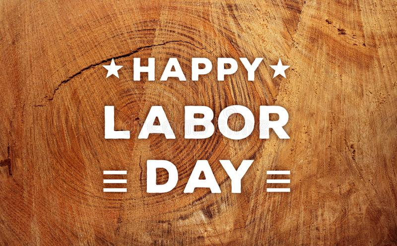 Happy Labor day banner. Happy Labor day, white text on hardwood surface top view banner stock photography