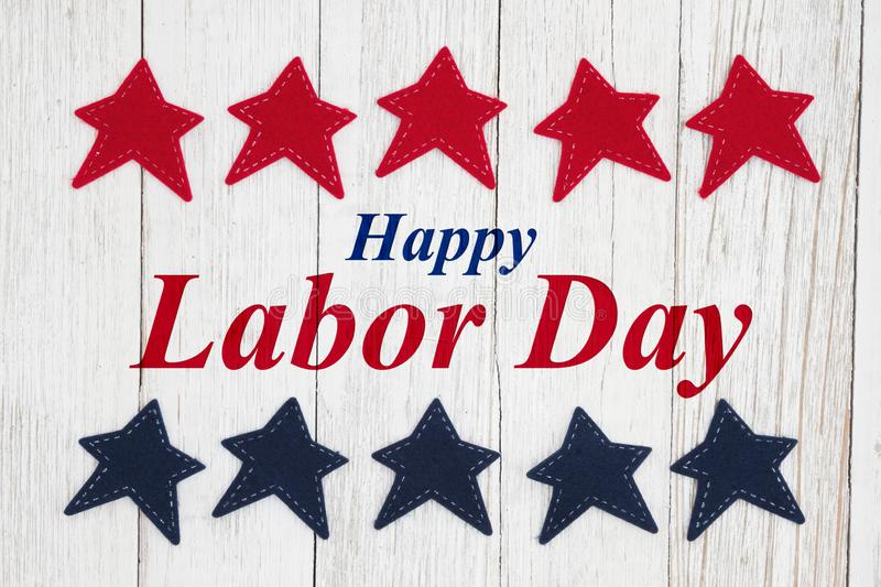 Happy Labor Day text with patriotic red and blue stars. On weathered whitewash textured wood vector illustration