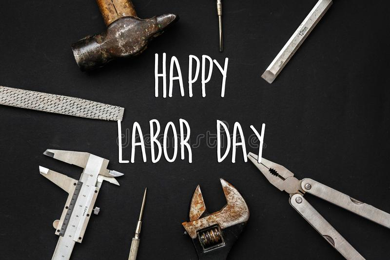 Happy labor day text sign. Tools for repairing and renovation co royalty free stock images