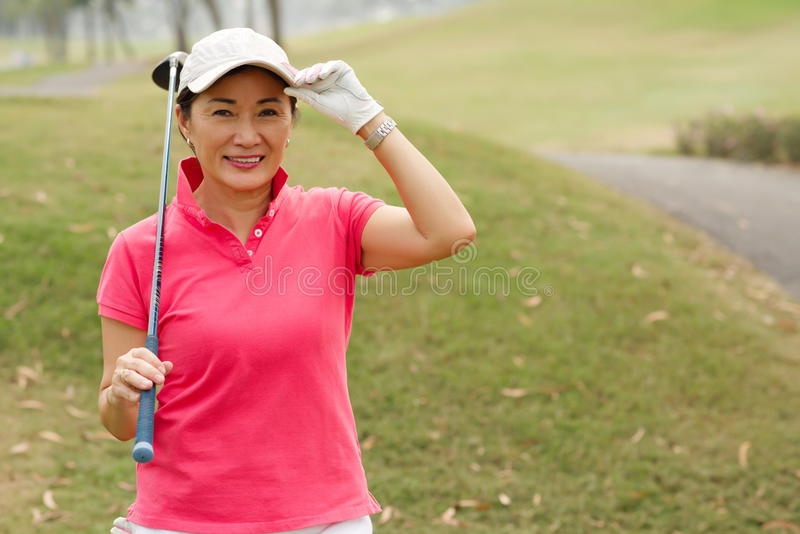Happy lady golfer stock photography