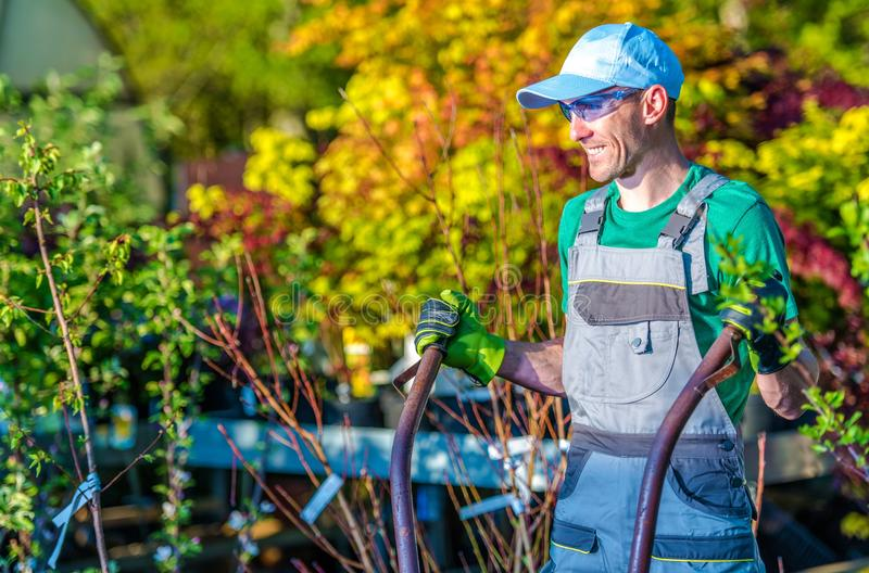 Happy Landscaping Worker. Caucasian Gardener in a Good Mood stock photos