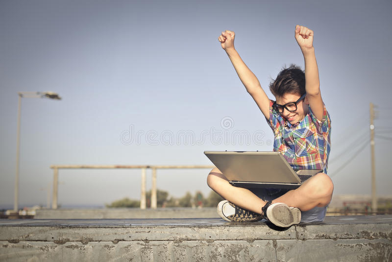Happy laptop user stock photo