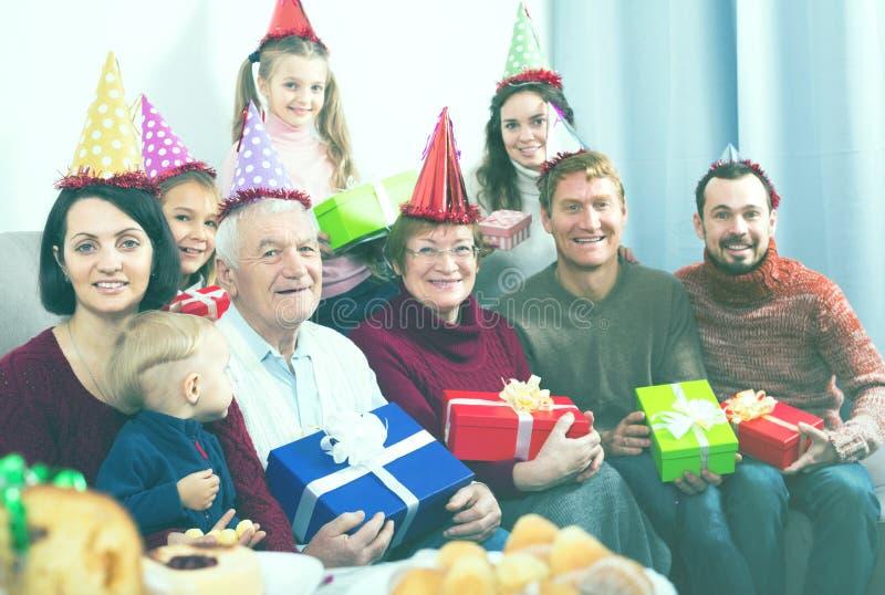 Happy large family making numerous photos stock image