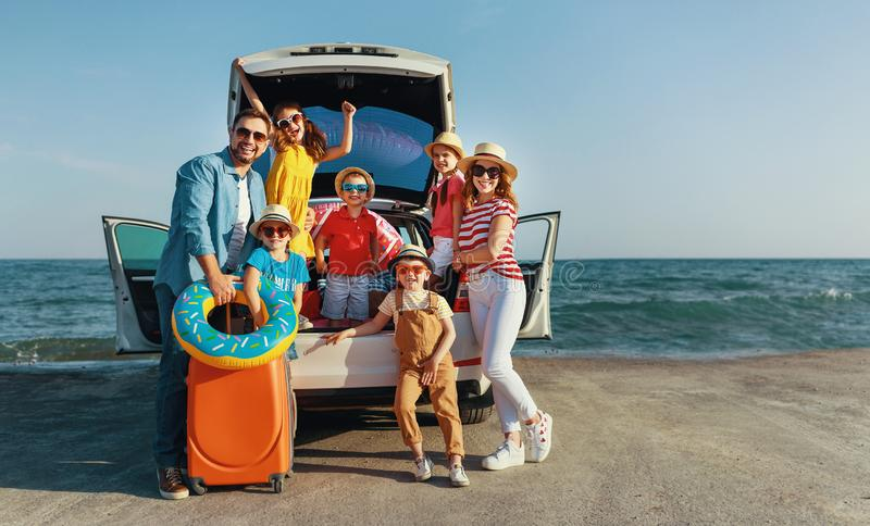 Happy large family  in summer auto journey travel by car on beach. Happy large family mother father and children in summer auto journey travel by car on beach stock photography