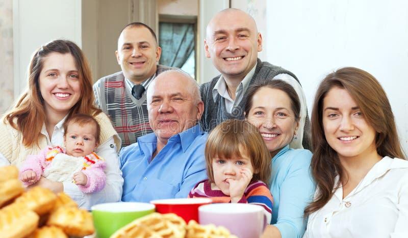 Happy large three generations family stock photo