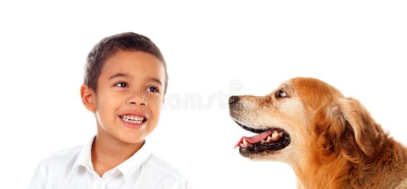 Happy latin boy and his dog stock photos