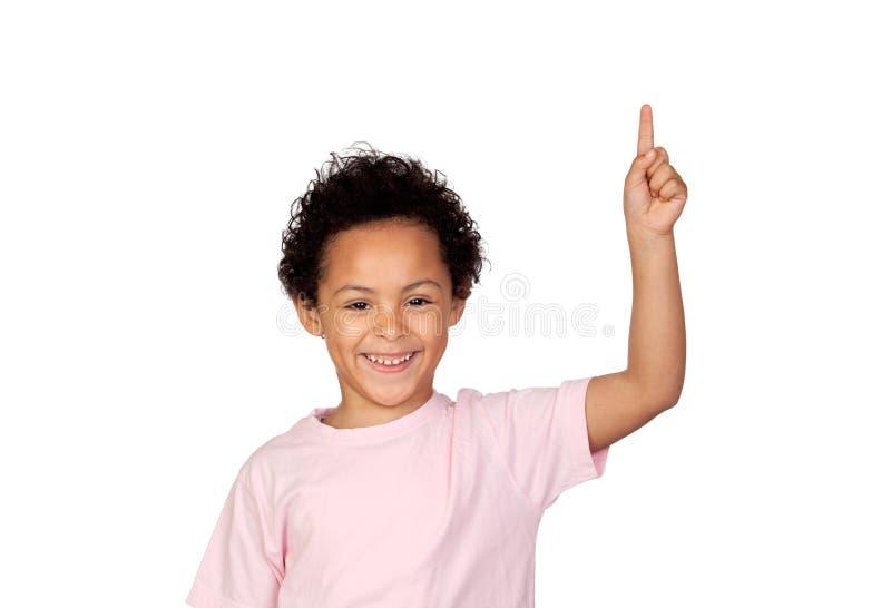 Happy latin child asking to speak stock image