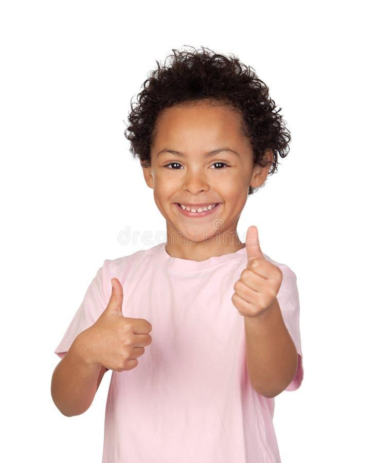 Happy latin child saying Ok royalty free stock photography