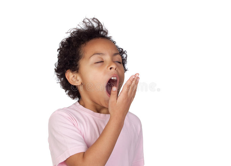 Happy latin child yawning stock photo