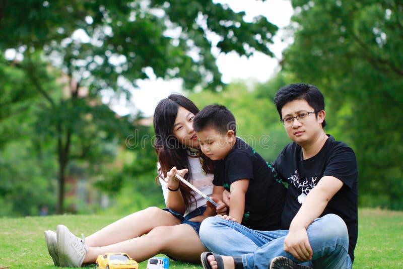 Happy latino family reading book stock photography