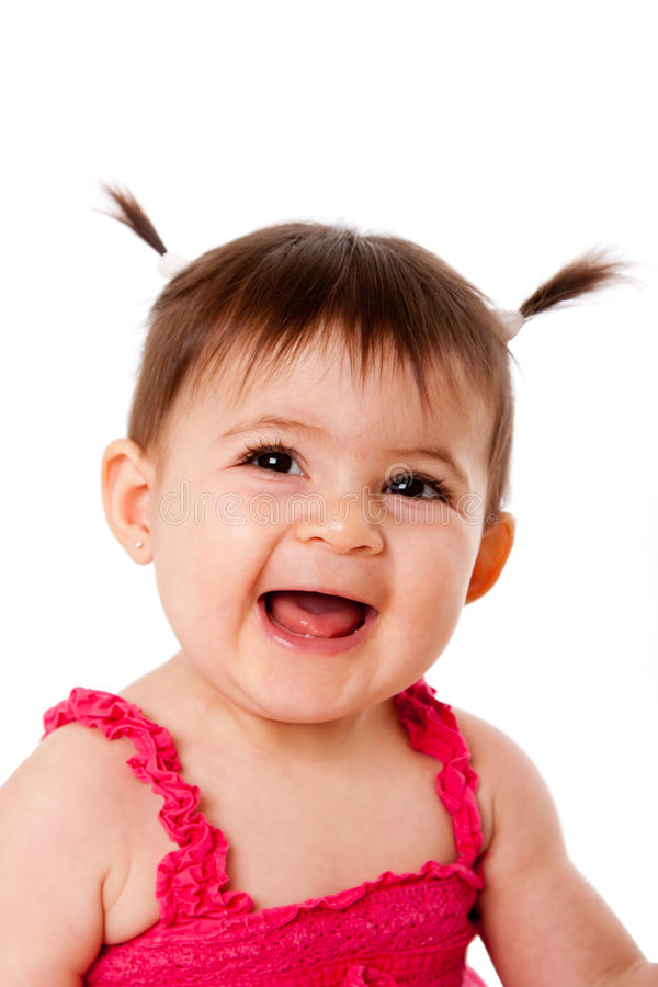 Happy laughing baby. Face of cute happy smiling laughing baby infant girl with ponytails, isolated stock photo