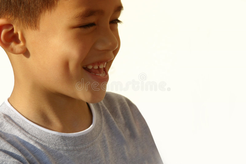 Happy and laughing boy. Closer shot of a happy and healthy boy with a dimple. Enough copy space stock photos