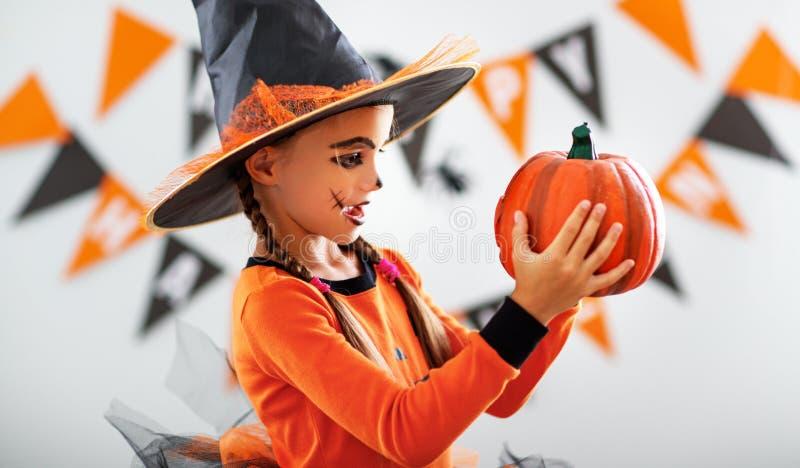 Happy child girl in pumpkin costume to halloween. Happy laughing child girl in pumpkin costume to halloween stock photography