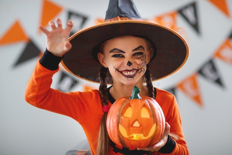 Happy child girl in pumpkin costume to halloween. Happy laughing child girl in pumpkin costume to halloween stock images