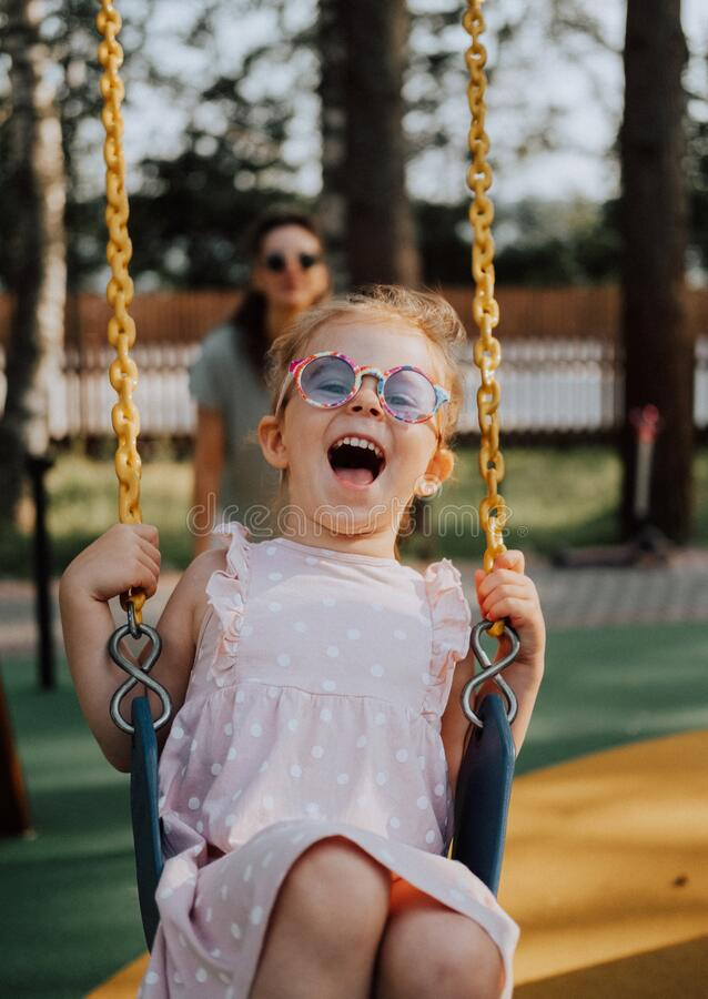 Free Happy Laughing Child On Swing In Summer Park. Girl In Sunglasses Have Fun. Royalty Free Stock Photos - 202775728
