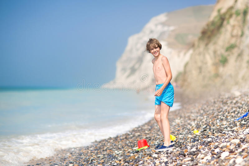 Happy laughing child playing on a beautiful beach stock photos