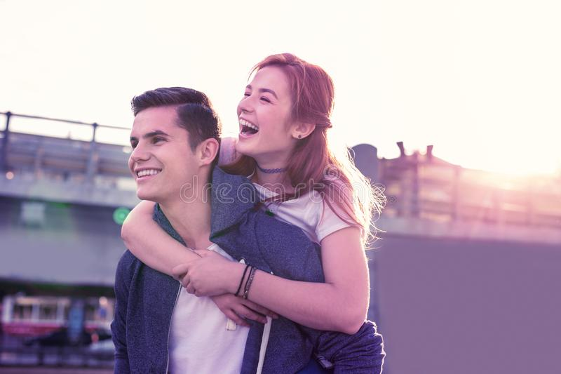 Happy laughing couple being extremely close to each other stock photography