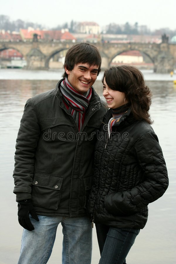 Happy laughing couple near the river royalty free stock photos