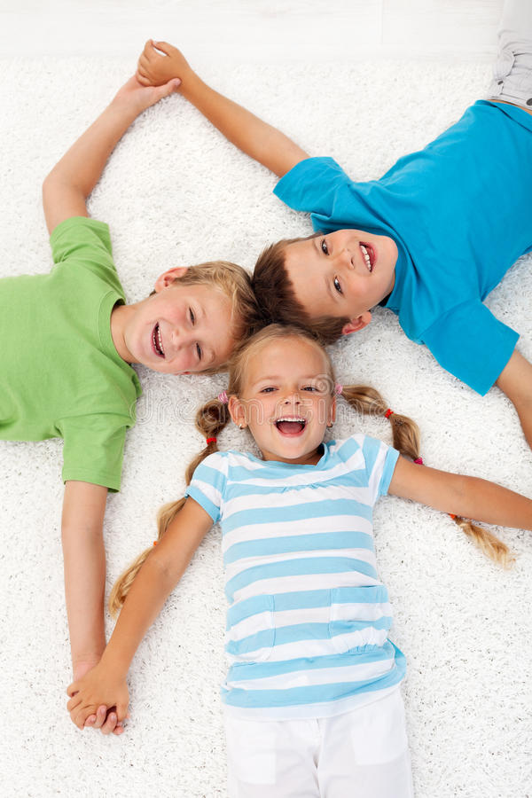 Download Happy Laughing Kids On The Floor Stock Image - Image: 21137133