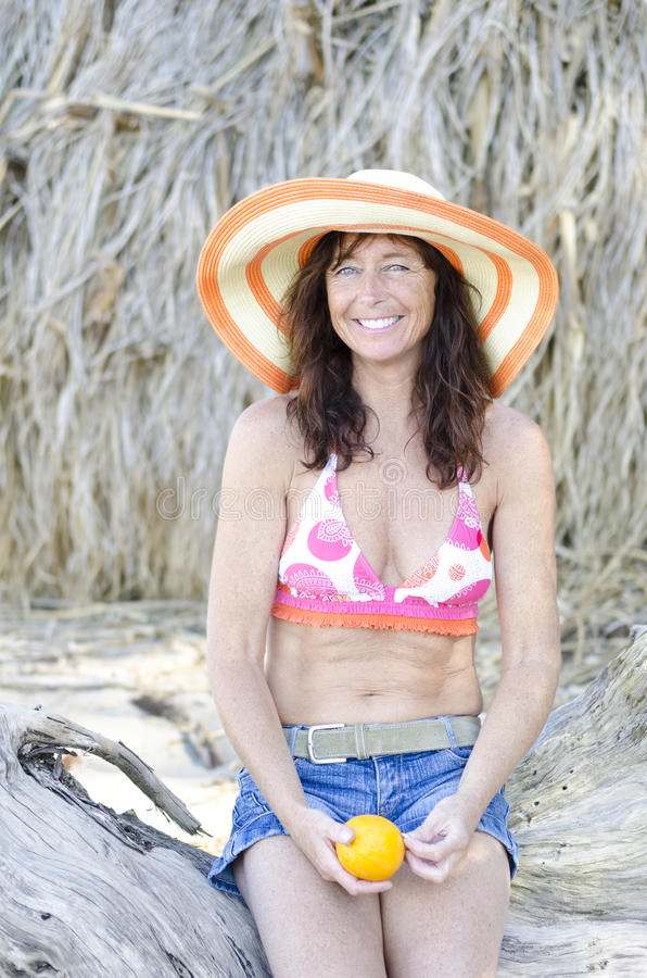 Download Happy Laughing Mature Woman On Beach Stock Image - Image: 24110431