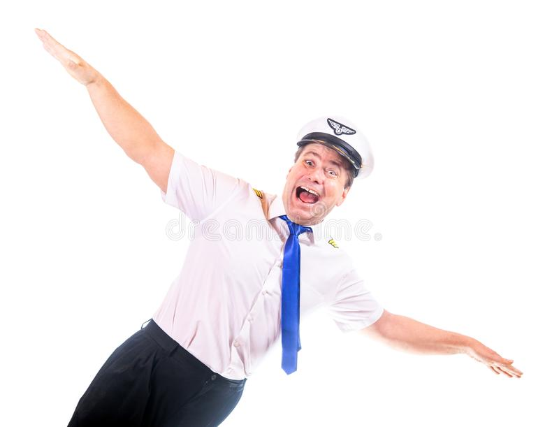 Happy laughing pilot in uniform gesturing flight. Isolated on white background. Captain of air plane with white shirt uniform stock images