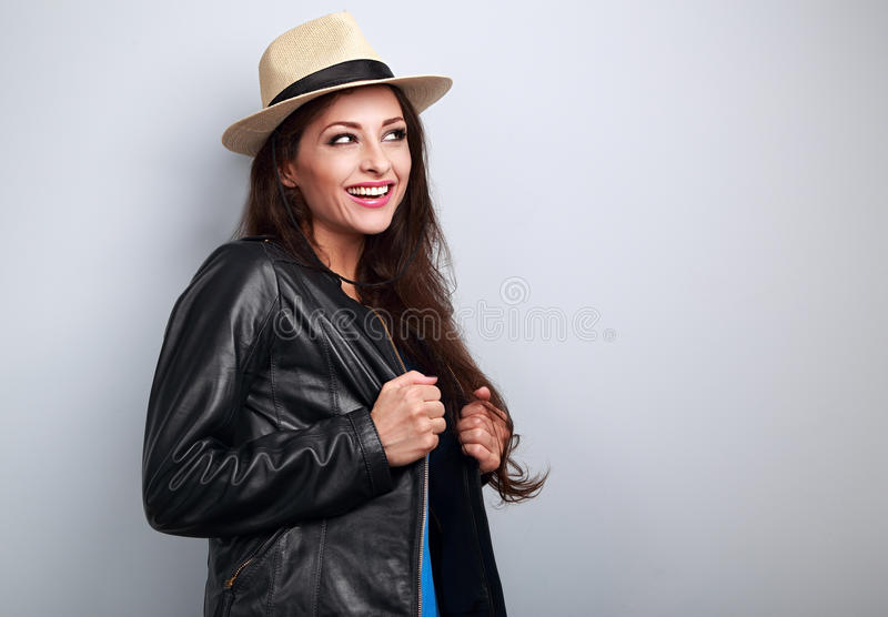Happy laughing woman in black jacket and straw hat looking royalty free stock images