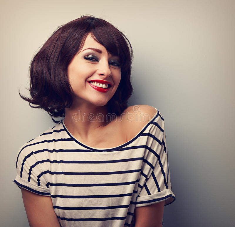Happy laughing young woman with short hair in fashion blouse. Vi. Ntage closeup portrait royalty free stock images