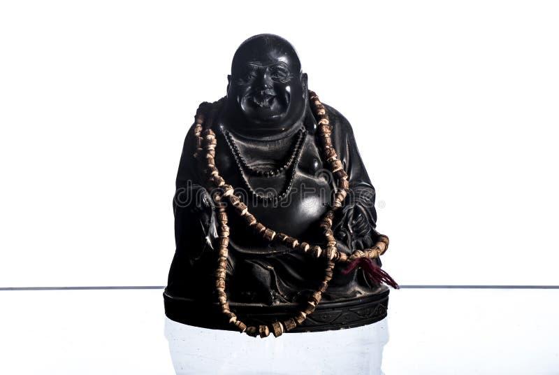 Happy lauphing buddha white background. Happy laughing Buddha brass figurine on white background royalty free stock photos