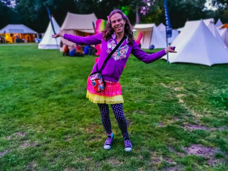 Happy LGBT portrait of a person wearing a flamboyant outfit with butterfly wings, castlefest festival 2 august 2019, keukenhof,. A happy LGBT portrait of a stock photos