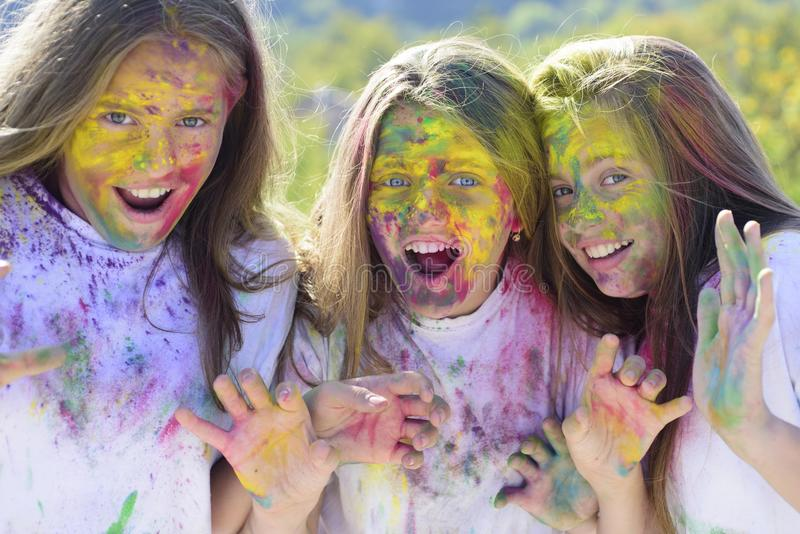 Happy life in teenager time. Crazy hipster girls. Summer weather. children with creative body art. colorful neon paint stock photo