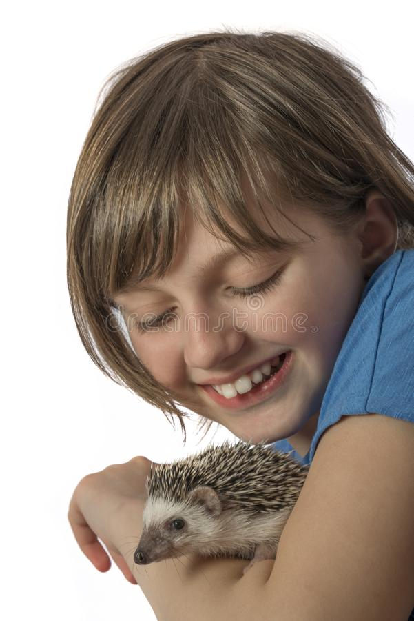 Happy litle girl with African pygmy hedgehog royalty free stock images