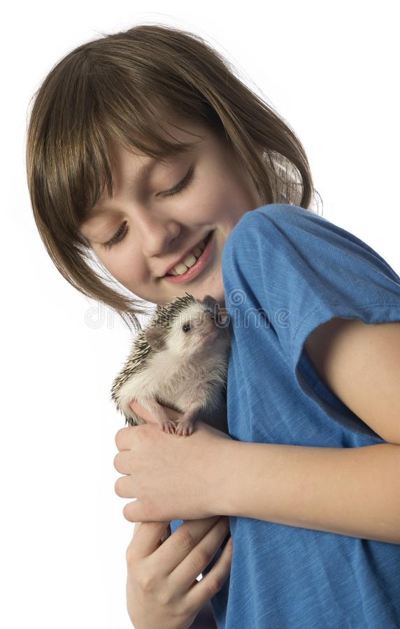 Happy litle girl with her pet African pygmy hedgehog stock photos