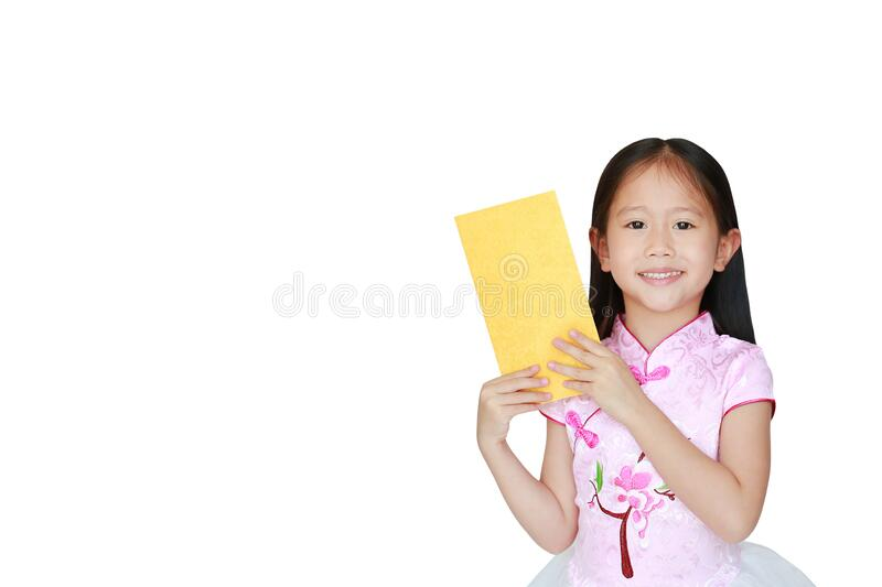 Happy little Asian child girl wearing pink traditional cheongsam dress smiling while receiving Chinese New Year gold envelope royalty free stock photos