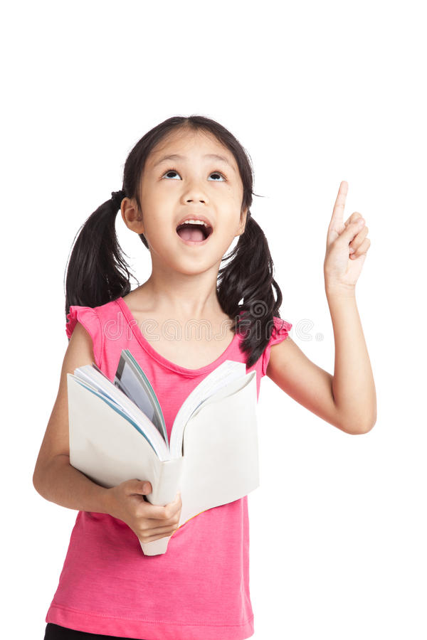 Happy little asian girl read a book and point up stock images