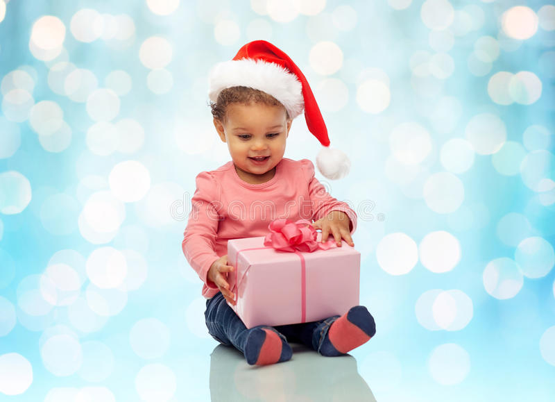 Happy little baby girl with christmas present stock photo