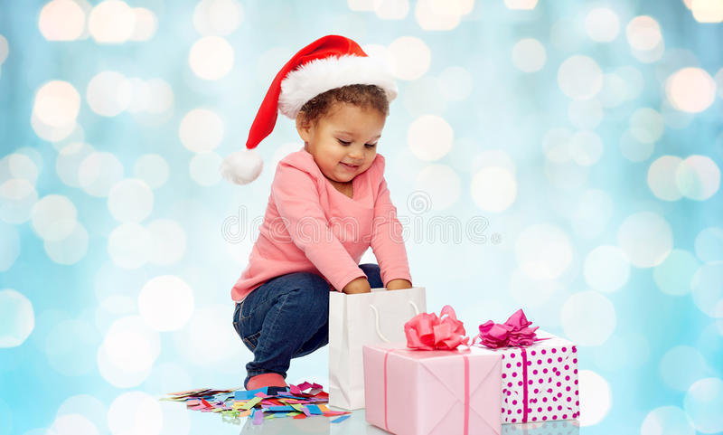 Happy little baby girl with christmas presents royalty free stock photo