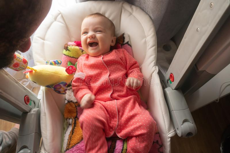 Happy little baby girl smiles royalty free stock photography