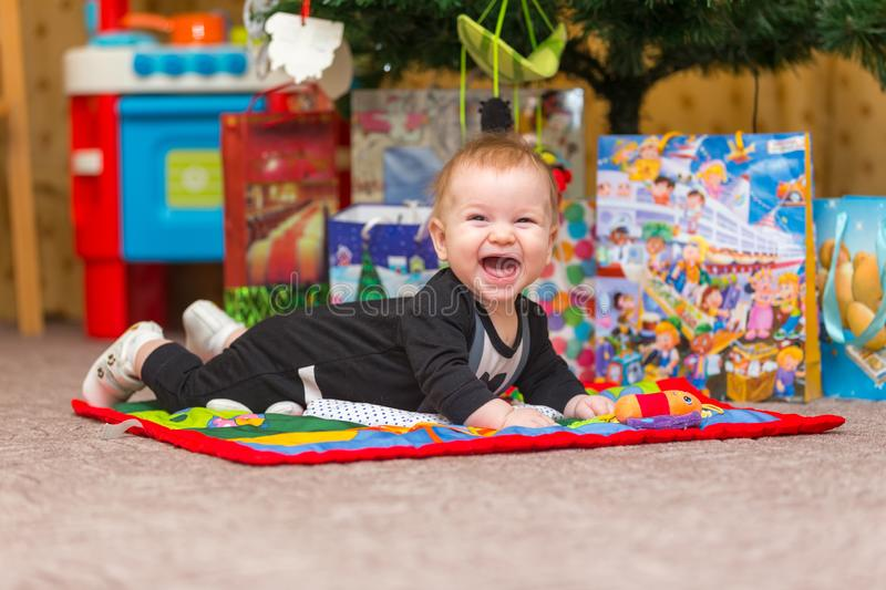 Happy little baby with lots of New Year presents on the background royalty free stock image