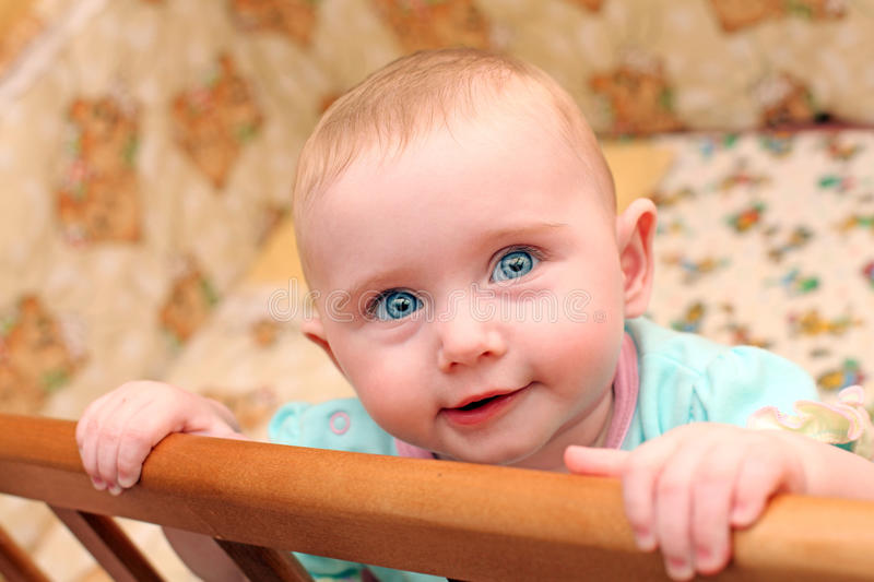 Happy Baby in Bassinet. Happy Little Baby Portrait in Bassinet royalty free stock photos