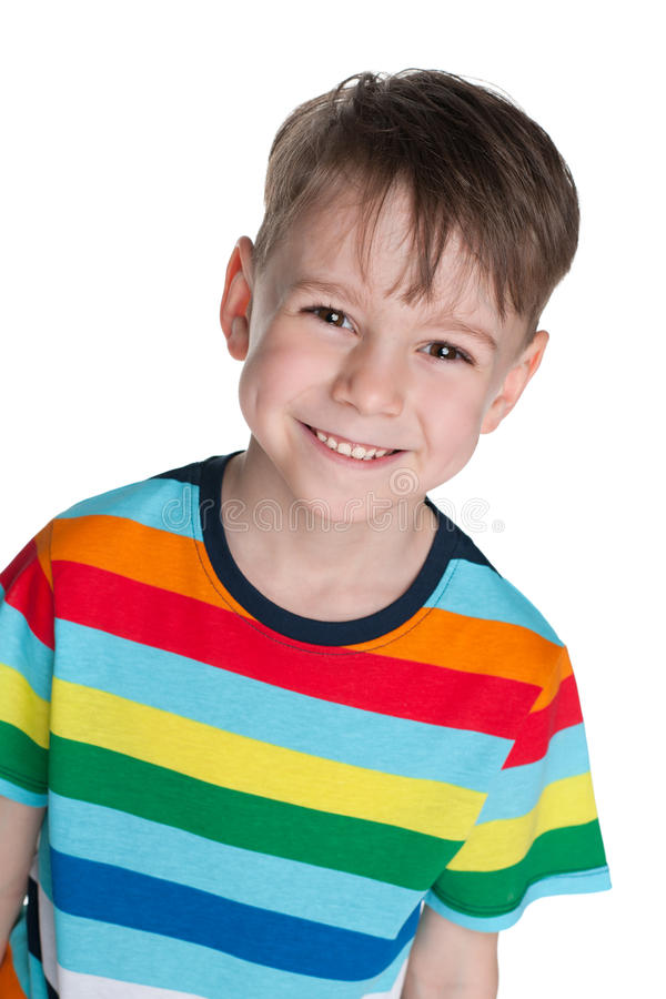 Happy little boy against the white stock photo