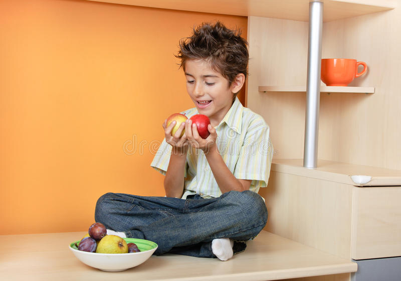 Happy little boy with apples