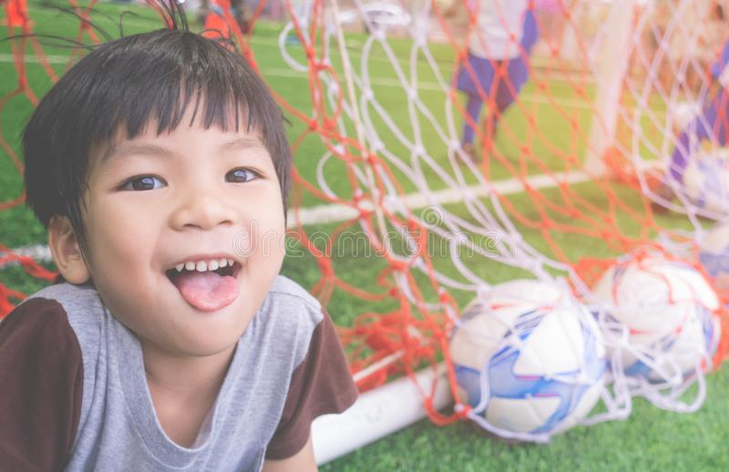 Happy Little boy behind the Goal in soccer training royalty free stock images
