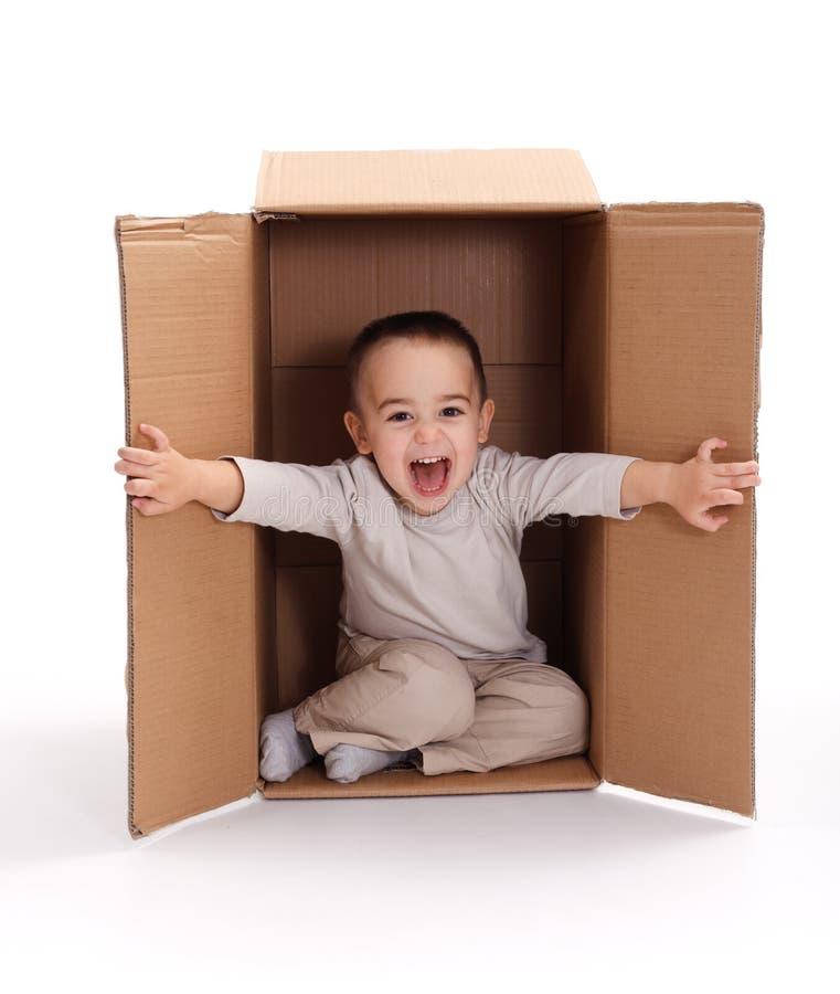 Happy Little Boy In Cardboard Box Stock Photos