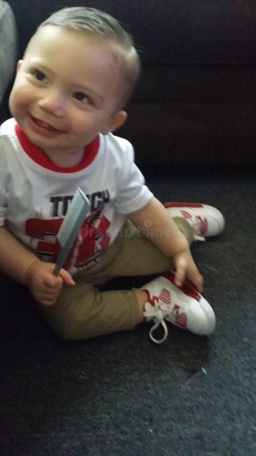 Happy little boy dressed in jordans royalty free stock image