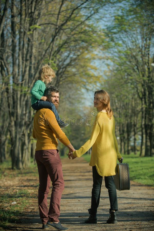 Happy little boy with family go on journey in park. Journey on foot. Where family fun begins.  royalty free stock photos