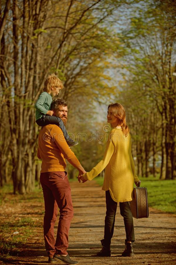 Happy little boy with family go on journey in park. Journey on foot. Where family fun begins.  royalty free stock photography