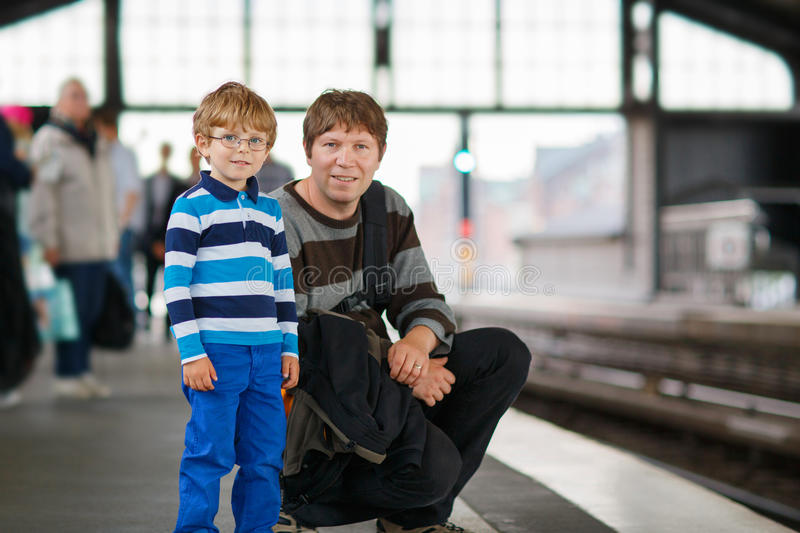 Happy little boy with father in a subway station. royalty free stock photos