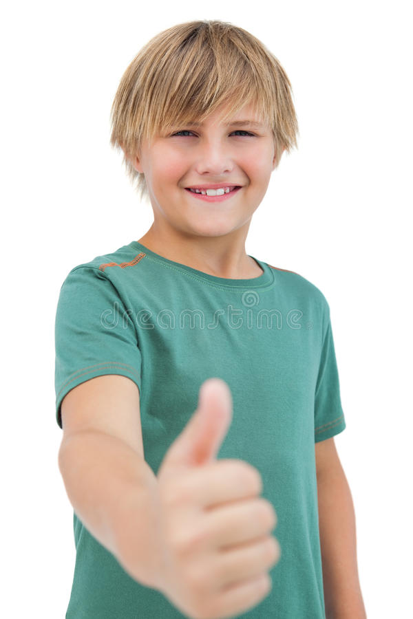 Happy little boy giving thumbs up royalty free stock image