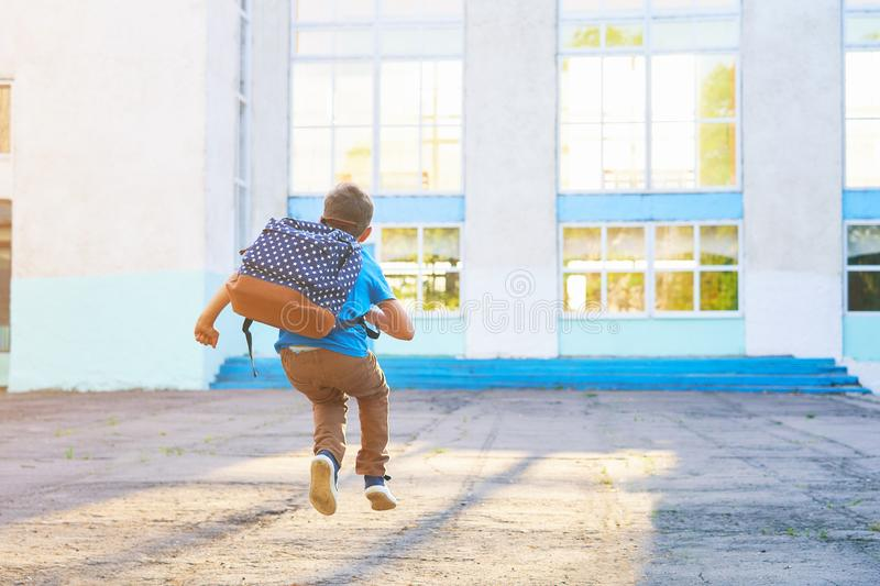 Happy little boy, high jumped with joy, the beginning of the school year.happy child goes to primary school. positive attitude to. Study. free text, copy space stock image
