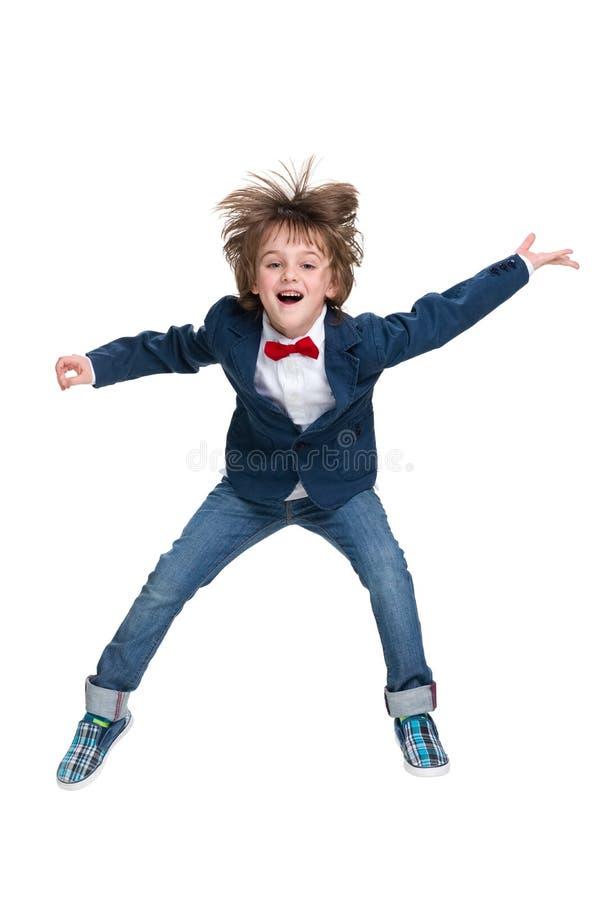 Happy little boy jumps stock photography